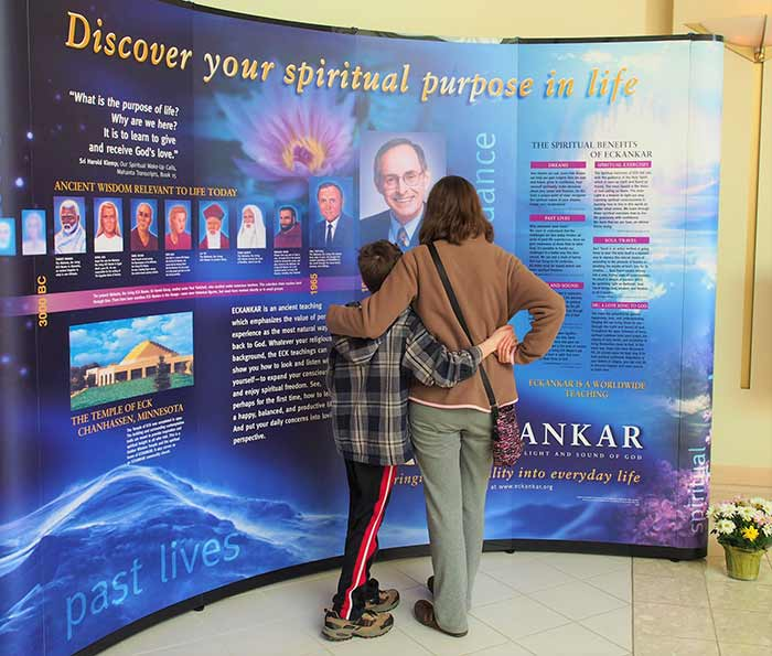 A mother and child looking at an Eckankar display together